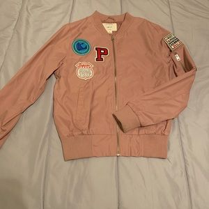 Pink bomber jacket with decorative patches